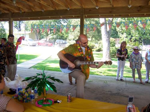 Staff Member Provides Entertainment at Annual Luau